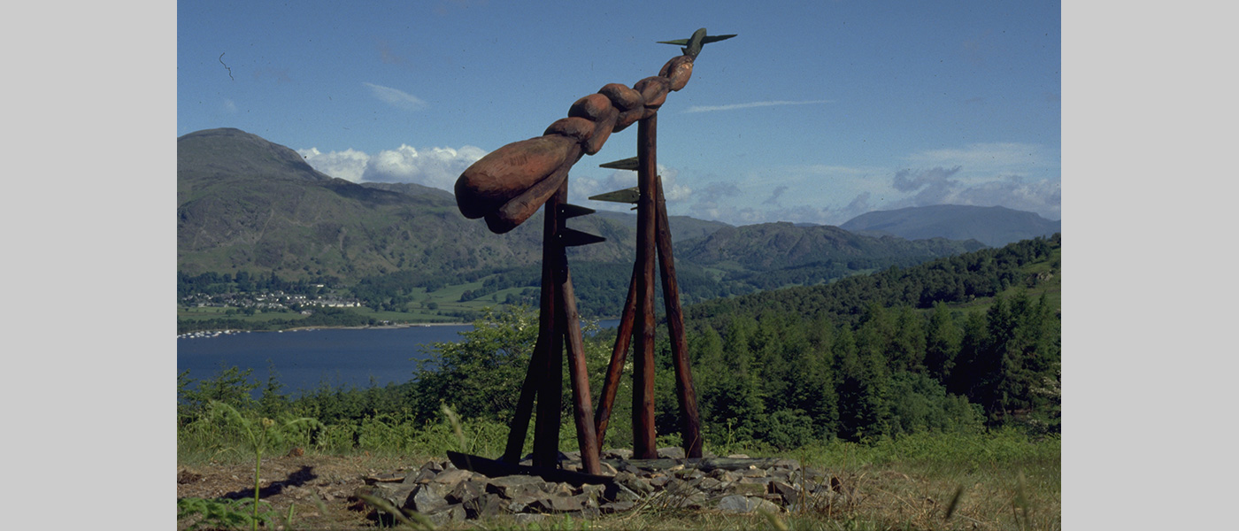 Title: To Fuel a Dream. Grizedale Forest, Cumbria. Situated in the Forest between Lake Windemere and Lake Coniston. 1989 Wood sculpture by Michael Winstone